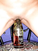 Asian stuffing herself with bottle