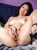 Thin Asian fingers her shaved pussy