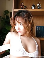 A busty Japanese beauty posing nude